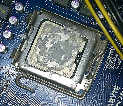dried thermal paste on processor